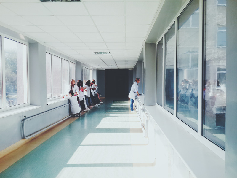 A doctor looking into a room.