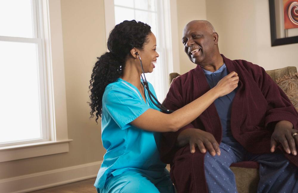 Photo of nurse with nursing home patient